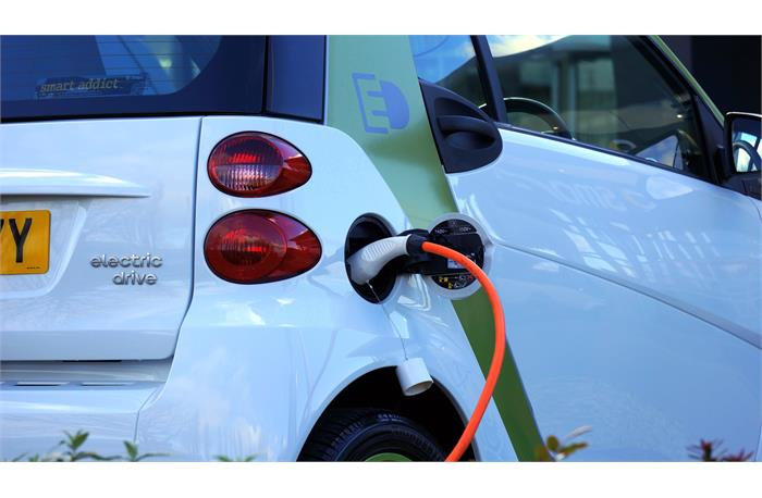 What does the trajectory look like for electric vehicles vs. fossil fuel powered cars?